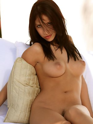 is an amazing brunette with a natural figure that screams sex