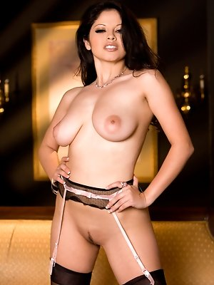Evie Delatosso roleplays the jaded, naughty contessa brazenly primping her full, firm naked breasts and long, gartered, stockinged legs while on the p